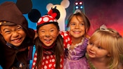 Children dressed as a Jedi Knight, Minnie Mouse, Rapunzel and Tinker Bell lock arms and smile during Mickey's Not-So-Scary Halloween Party