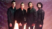 An illuminated portrait of the 4 member band, Newsboys