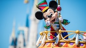 Mickey Mouse vibrantly costumed during the Disney Festival of Fantasy Parade at Magic Kingdom park