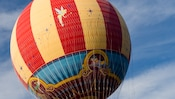 Tethered hot-air balloon floats over Downtown Disney area at night