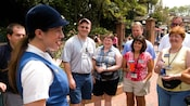 Tour guide with tour group in the park