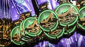 A display of circular medals embedded with an image of a glass slipper and the words Disney Glass Slipper Challenge