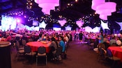 A busy indoor dining event featuring  3 stages and buffet areas