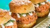 3 biscuit sandwiches filled with salmon, dill and cheese