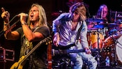 Images of the band Foghat performing onstage