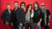 Multiple male & female members of the rock group Starship, including Mickey Thomas, posing together