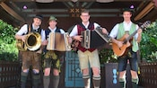 Members of the Bavarian band Wies N Baum with instruments in hand at the Germany Pavilion at Epcot