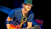 Singer, songwriter, guitarist and keyboard player Devon Allman plays guitar on stage