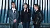 Publicity shot for American pop band Hanson, with Isaac, Taylor and Zac Hanson in front of striped wall