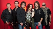 Members of STARSHIP starring Mickey Thomas posing together while wearing fashionable music apparel