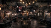 A dark, atmospheric room that looks like the hold of a pirate ship, with leather makeup chairs