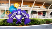 Purple and blue sign reads 'Walt Disney's Carousel of Progress' at Magic Kingdom theme park