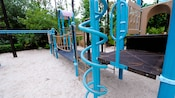 Bright blue twisted bars and climbing ropes on a playground at Disney's All-Star Sports Resort