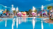 "Characters from 'Little Nemo"" decorate the Big Blue Pool of Disney's Art of Animation Resort at night."