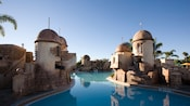 The Fuentes del Morro swimming pool with towers themed like a colonial Caribbean fortress