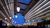 The main concourse of Disney's Contemporary Resort with the monorail zooming by