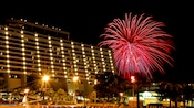 Fireworks burst in the sky near Disney's Contemporary Resort