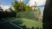 View from the back of a basketball hoop and the court