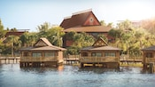 Three overwater bungalows reflect the feel of the South Pacific with wood accents and surrounding palm trees