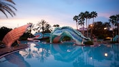 The sea serpent waterslide at the Doubloon Lagoon Pool area at dusk