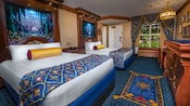 2 royal beds with richly brocaded bed throws, elaborate headboards, curtained window with garden view