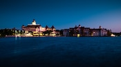 Disney's Grand Floridian Resort & Spa, as seen from Seven Seas Lagoon at night