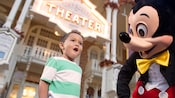 A little boy wears an expression of awe as he meets Mickey Mouse in from of Town Square Theater
