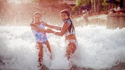 Two girls enjoying a water park