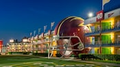 The illuminated football themed courtyard at Disney's All Star Sports Resort featuring a gigantic helmet