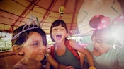 Three young girls enjoy a ride on Mad Tea Party.