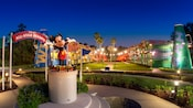 Large football helmets outside Disney's All Star Resort lit up at night