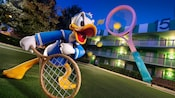 A large lawn ornament of Donald Duck holding a tennis racket in the courtyard of Disney's All-Star Sports Resort