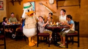 Safari Donald Duck greeting a mother and son at a Character Breakfast