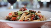 Rigatoni with Italian sausage, mushrooms, tomatoes, olives and escarole in bowl