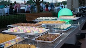 A table of cookies, pastries and other sweet treats await VIP Guests at the IllumiNations Dessert Party