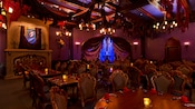 The darkened interior of the West Wing dining room at Be Our Guest restaurant