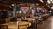 Dining area with an Old West theme and a old American flag on the wall
