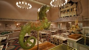A green carousel 'seahorse' with a horse head and scaly fish tail presides over the dining room