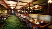 Outdoor patio seating at Turf Club Bar & Grill