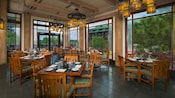 Oak furnishings, wood beams and large windows with forest views in the Artist Point dining room