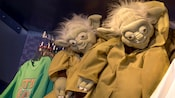 2 Yoda backpacks on  hanging on display at Tatooine Traders