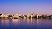 A view from across Crescent Bay of a ferryboat heading toward Disney's Yacht Club Resort