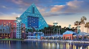 Waterfront view of the Walt Disney World Dolphin Hotel at dusk