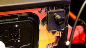 Close-up of a pinball game's lever that starts the game