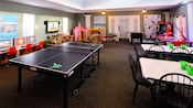 A ping-pong table, 2 crafts tables, an air hockey game and video stations in a Community Hall