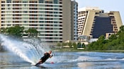 A man waterskiing on Bay Lake in front of Bay Lake Tower at Disney's Contemporary Resort