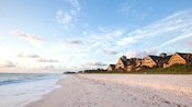 Panoramic view of the Resort buildings with the beach and ocean in the foreground