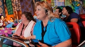 Women with hearing disabilities enjoy a Disneyland attraction by using the Assistive Listening System