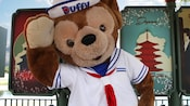 Duffy the Disney Bear gives a sailor's salute