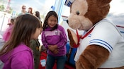 Young girls meet Duffy the Disney Bear at the Disneyland Resort
